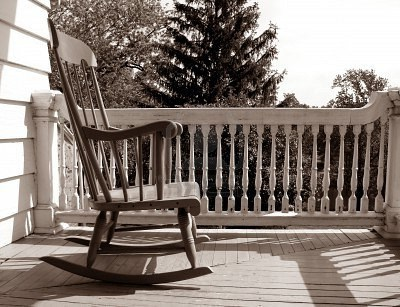 1718009-rocking-chair-on-an-old-house-porch-e1395746610210