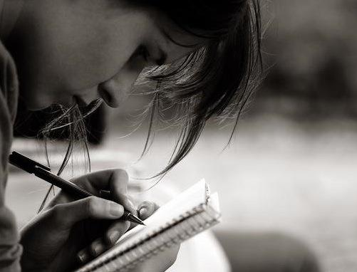 gloria-woman-writing